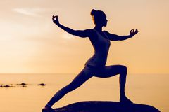 Caucasian fitness woman practicing yoga Stock Photo