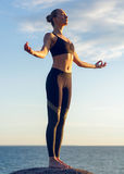 Caucasian fitness woman practicing yoga Stock Images