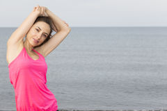 Caucasian fitness woman stretching her triceps Stock Photo