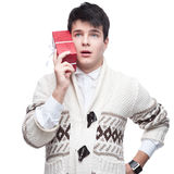 Caucasian funny casual young man holding gift Stock Image