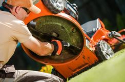 Checking Lawn Mower Blades royalty free stock photos