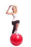 Caucasian girl accomplishing hips exrecises Stock Photos