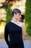 Caucasian girl in black dress Stock Photo