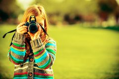 Caucasian Girl with Camera Royalty Free Stock Image