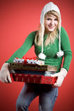 Caucasian girl carrying gifts Royalty Free Stock Image