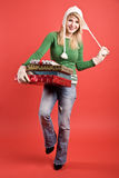 Caucasian girl carrying gifts on holiday Royalty Free Stock Images