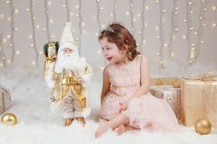 Caucasian girl celebrating Christmas or New Year. Portrait of cute smiling white Caucasian girl celebrating Christmas or New Year. Little adorable cute child Royalty Free Stock Photo