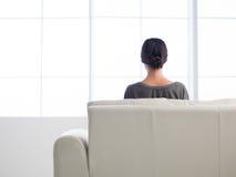 Caucasian girl chilling on sofa Stock Photos