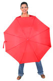 Caucasian Girl Covered With Red Umbrella. Caucasian young woman cover herself with red umbrella stock images