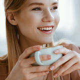 Caucasian girl drinking coffee in cafe, coffee break concept Stock Photos