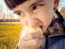 Caucasian girl eating apple Stock Photos