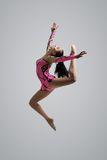 Caucasian girl gymnast jumping Royalty Free Stock Images