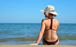 Caucasian girl with hat on the beach. Stock Images