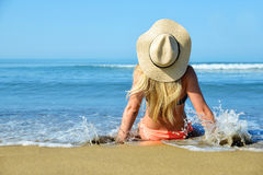 Caucasian girl with hat on the beach Stock Image