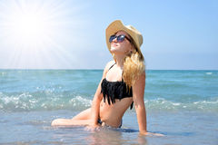 Caucasian girl with hat on the beach. Stock Image