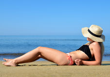 Caucasian girl with hat on the beach. Royalty Free Stock Photography