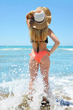 Caucasian girl with hat on the beach. Stock Photo