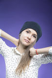 Caucasian  Girl in Hat Looking Straight To Camera. Against Dark Blue  Background Stock Photography