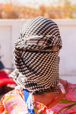 Caucasian girl in head kerchief in the desert Stock Photos