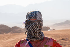 Caucasian girl in head kerchief in the desert Royalty Free Stock Photography