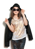 Girl in a leather jacket and black hat Royalty Free Stock Photography