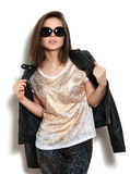 Girl in a leather jacket and sunglasses Stock Photos