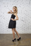 Caucasian girl in Little black dress Stock Photo