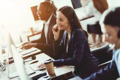 Caucasian Girl Looks At Work In The Call Center. Stock Photography