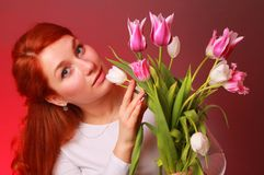 Caucasian girl with lovely flowers Stock Photos