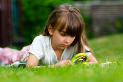 Caucasian girl with magnifying glass Stock Photo
