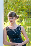 Caucasian girl with opened eyes in black dress Stock Images