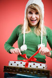 Caucasian girl opening gift Royalty Free Stock Images