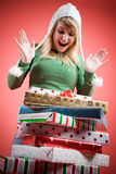 Caucasian girl receiving christmas gifts Royalty Free Stock Images