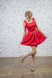 Caucasian Girl in red party dress Royalty Free Stock Images