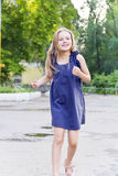 Caucasian girl run in summer with disheveled hair Royalty Free Stock Image