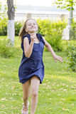 Caucasian girl run in summer with disheveled hair Stock Images