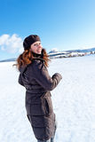 Caucasian girl running on snow Stock Photo