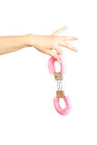 Caucasian girl`s hand holding handcuffs. Isolated Stock Photo