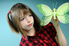 Caucasian girl showing butterfly toy Stock Images