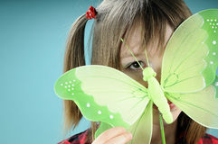 Caucasian girl showing butterfly toy Stock Image