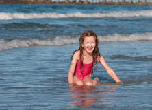 Caucasian girl, sitting on the beach . Stock Photography