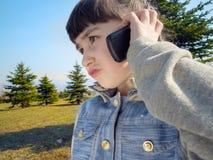 Caucasian girl talk to mobile phone Royalty Free Stock Photos
