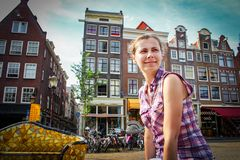 Caucasian girl tourist in Amsterdam. Holidays in Europe. Travel to the European city of Amsterdam, the Netherlands. Vacations in Holland Stock Images