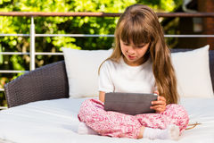 Caucasian girl using tablet Stock Images