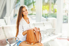 Caucasian girl in a waiting hall Stock Photo