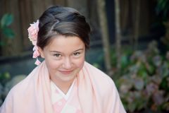Caucasian girl wearing a traditional Japanese kimono stock photography