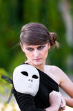 Caucasian girl with white mask on shoulder Stock Photography