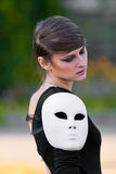 Caucasian girl white mask on shoulder Stock Photo