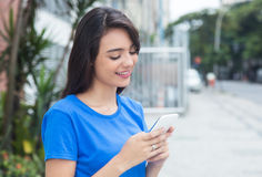 Free Caucasian Girl With Blue Shirt Using Wifi With Phone Royalty Free Stock Images - 64107099