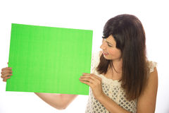 Caucasian girl woman holding message board. White background studio surprised Stock Photo